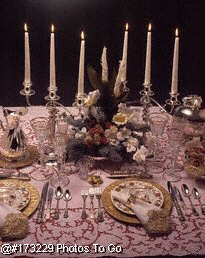 Fancy silver and gold table setting with